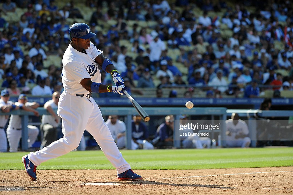 <a gi-track='captionPersonalityLinkClicked' href=/galleries/search?phrase=Yasiel+Puig&family=editorial&specificpeople=10484087 ng-click='$event.stopPropagation()'>Yasiel Puig</a> #66 of the Los Angeles Dodgers hits a walk off homerun in the eleventh inning to defeat the Cincinnati Reds 1-0 at Dodger Stadium on July 28, 2013 in Los Angeles, California.