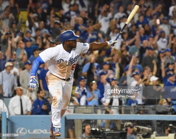 Yasiel Puig of the Los Angeles Dodgers hits a walk off three run home run to defeat the Chicago White Sox in the ninth inning of the game at Dodger...