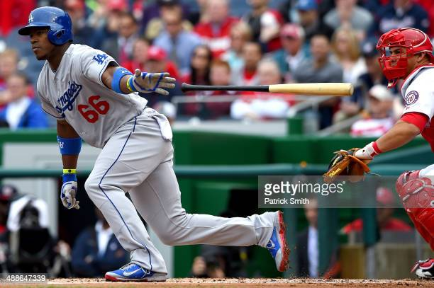 Yasiel Puig of the Los Angeles Dodgers hits an RBI single in the first inning against the Washington Nationals at Nationals Park on May 7 2014 in...