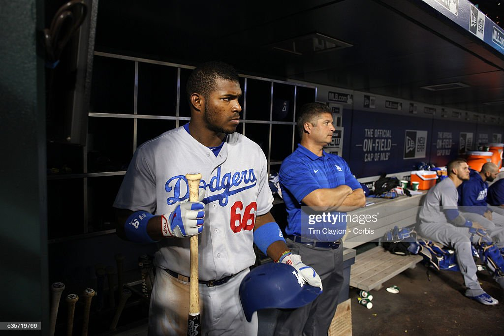 <a gi-track='captionPersonalityLinkClicked' href=/galleries/search?phrase=Yasiel+Puig&family=editorial&specificpeople=10484087 ng-click='$event.stopPropagation()'>Yasiel Puig</a> #66 of the Los Angeles Dodgers in the dugout preparing to bat during the Los Angeles Dodgers Vs New York Mets regular season MLB game at Citi Field on May 27, 2016 in New York City.