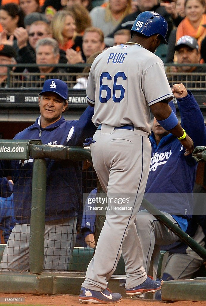 Yasiel Puig #66 of the Los Angeles Dodgers is congratulated by manager Don Mattingly #8 (L) after Puig scored in the third inning against the San Francisco Giants at AT&T Park on July 5, 2013 in San Francisco, California.