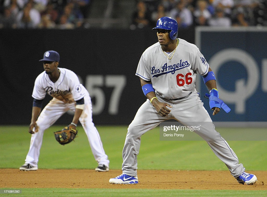 <a gi-track='captionPersonalityLinkClicked' href=/galleries/search?phrase=Yasiel+Puig&family=editorial&specificpeople=10484087 ng-click='$event.stopPropagation()'>Yasiel Puig</a> #66 of the Los Angeles Dodgers leads off second base in front of <a gi-track='captionPersonalityLinkClicked' href=/galleries/search?phrase=Pedro+Ciriaco&family=editorial&specificpeople=5718591 ng-click='$event.stopPropagation()'>Pedro Ciriaco</a> #3 of the San Diego Padres during the seventh inning of a baseball game at Petco Park on June 21, 2013 in San Diego, California.