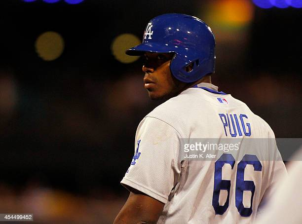 Yasiel Puig of the Los Angeles Dodgers looks on against the Pittsburgh Pirates during the game at PNC Park July 23 2014 in Pittsburgh Pennsylvania