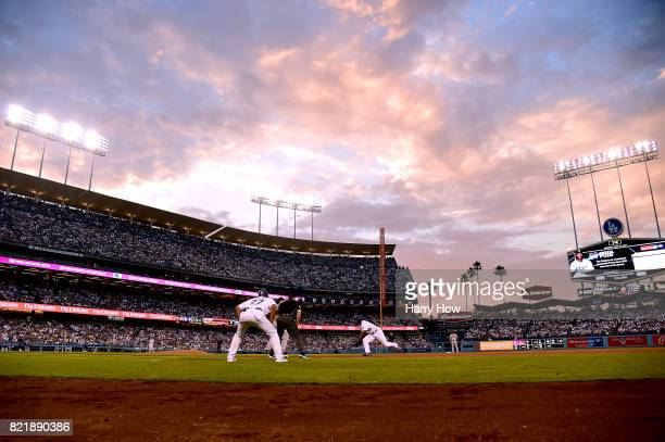 Yasiel Puig of the Los Angeles Dodgers lunges back to first base to beat a throw during the third inning at Dodger Stadium on July 24 2017 in Los...