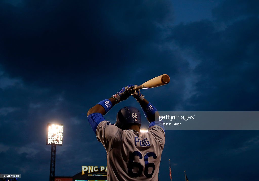 Yasiel Puig #66 of the Los Angeles Dodgers on deck in the sixth inning during the game against the Pittsburgh Pirates at PNC Park on June 24, 2016 in Pittsburgh, Pennsylvania.