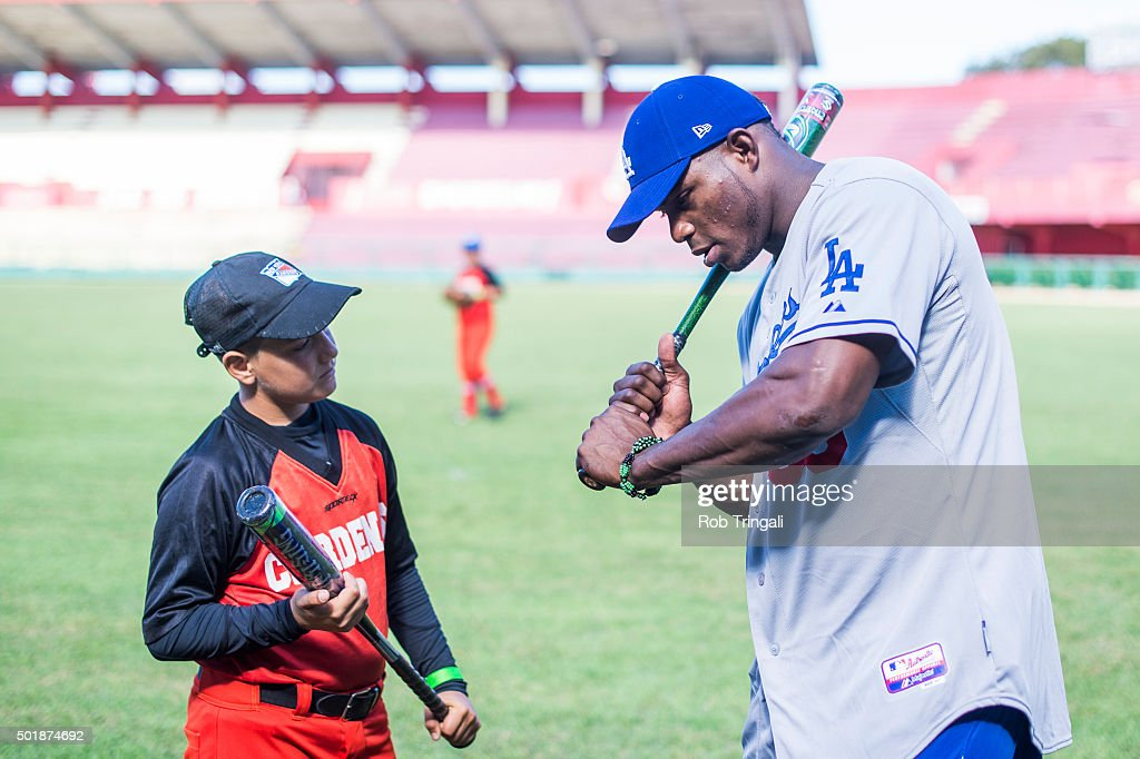 <a gi-track='captionPersonalityLinkClicked' href=/galleries/search?phrase=Yasiel+Puig&family=editorial&specificpeople=10484087 ng-click='$event.stopPropagation()'>Yasiel Puig</a> of the Los Angeles Dodgers participates in a youth clinic during an MLB goodwill tour on December 17, 2015 at Estadio Victoria de Giron in Matanzas, Cuba.