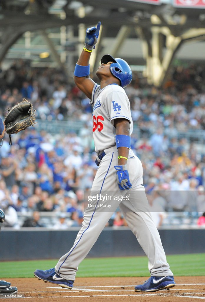 <a gi-track='captionPersonalityLinkClicked' href=/galleries/search?phrase=Yasiel+Puig&family=editorial&specificpeople=10484087 ng-click='$event.stopPropagation()'>Yasiel Puig</a> #66 of the Los Angeles Dodgers points skyward after hitting a solo home run during the first inning of a baseball game against the San Diego Padres at Petco Park on June 20, 2013 in San Diego, California.