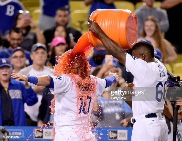 Yasiel Puig of the Los Angeles Dodgers pours Gatorade over the head of Justin Turner in celebration of his game winning single for a 65 win over the...