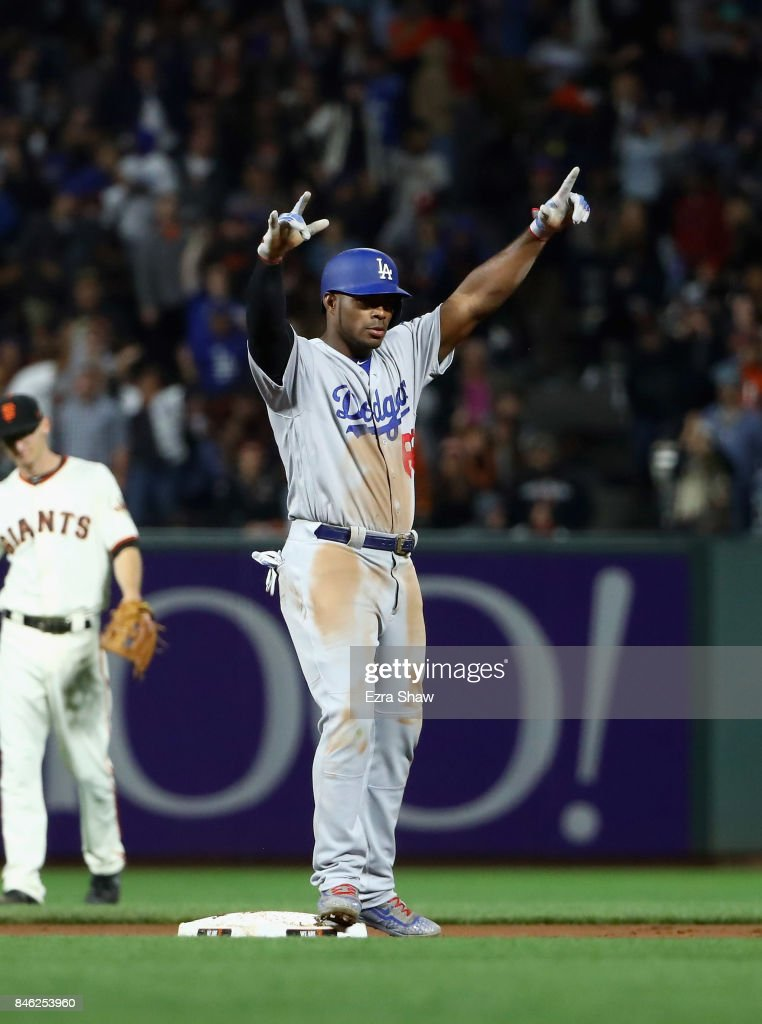 Yasiel Puig #66 of the Los Angeles Dodgers reacts after he hit a double that scored two runs in the fourth inning against the San Francisco Giants at AT&T Park on September 12, 2017 in San Francisco, California.