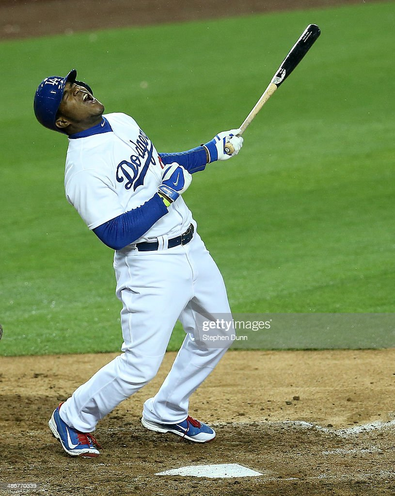 Yasiel Puig #66 of the Los Angeles Dodgers reacts after hitting a fly ball in the eighth inning against the Colorado Rockies at Dodger Stadium on April 25, 2014 in Los Angeles, California.