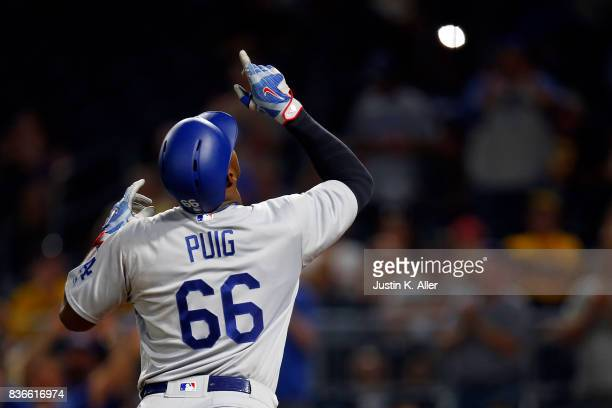 Yasiel Puig of the Los Angeles Dodgers reacts after hitting a solo home run in the twelfth inning against the Pittsburgh Pirates at PNC Park on...