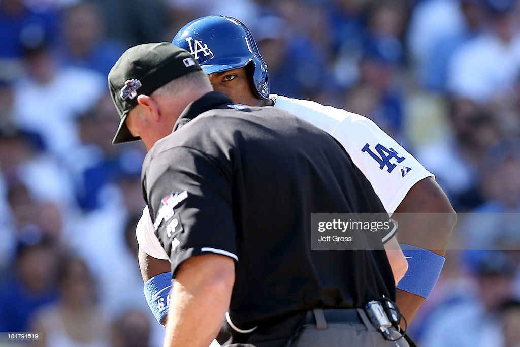 <a gi-track='captionPersonalityLinkClicked' href=/galleries/search?phrase=Yasiel+Puig&family=editorial&specificpeople=10484087 ng-click='$event.stopPropagation()'>Yasiel Puig</a> #66 of the Los Angeles Dodgers reacts after striking out in the fourth inning alongside home plate umpire Ted Barrett against the St. Louis Cardinals in Game Five of the National League Championship Series at Dodger Stadium on October 16, 2013 in Los Angeles, California.