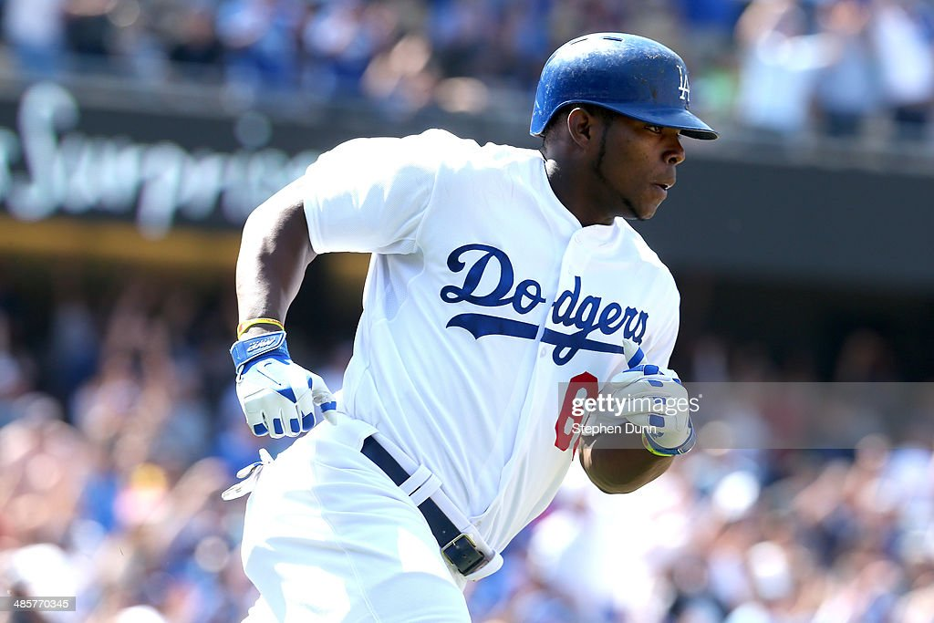 <a gi-track='captionPersonalityLinkClicked' href=/galleries/search?phrase=Yasiel+Puig&family=editorial&specificpeople=10484087 ng-click='$event.stopPropagation()'>Yasiel Puig</a> #66 of the Los Angeles Dodgers rounds first base after hitting a three run home run in the sixth inning against at Dodger Stadium on April 20, 2014 in Los Angeles, California.