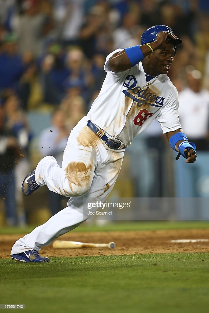 <a gi-track='captionPersonalityLinkClicked' href=/galleries/search?phrase=Yasiel+Puig&family=editorial&specificpeople=10484087 ng-click='$event.stopPropagation()'>Yasiel Puig</a> #66 of the Los Angeles Dodgers rounds home plate with the game winning run scored off a double by Adrian Gonzalez #23 of the Los Angeles Dodgers in the twelfth inning against the New York Mets at Dodger Stadium on August 14, 2013 in Los Angeles, California.