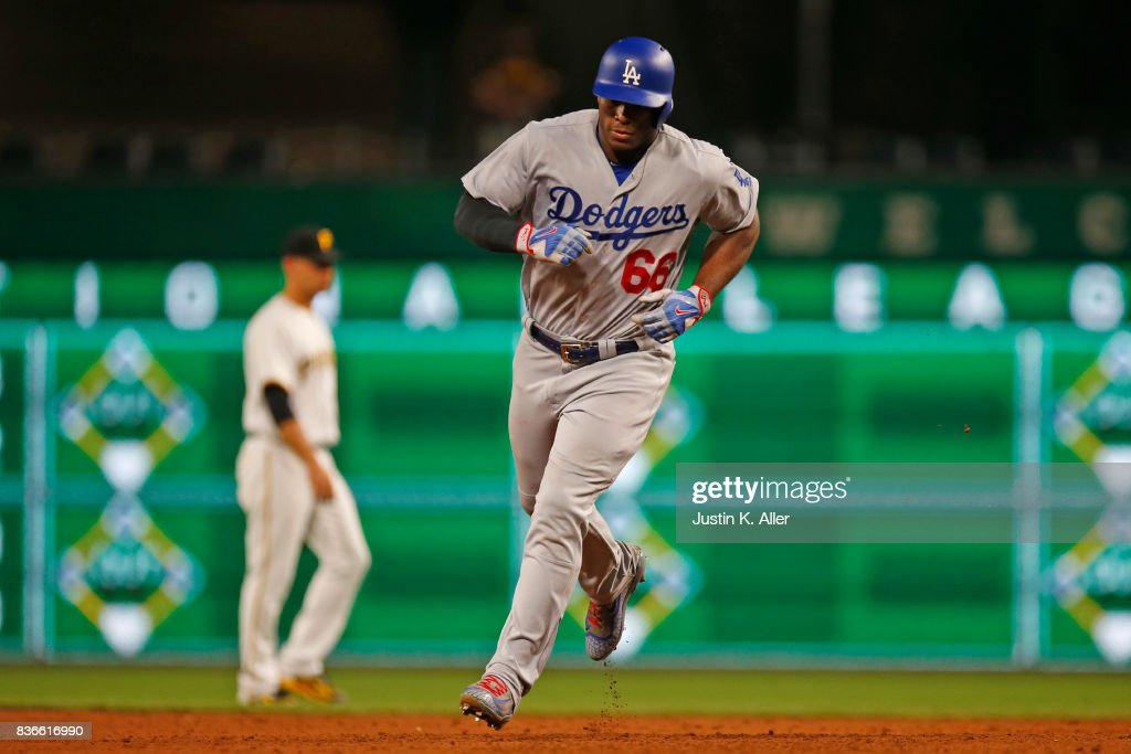 Yasiel Puig #66 of the Los Angeles Dodgers rounds second after hitting a solo home run in the twelfth inning against the Pittsburgh Pirates at PNC Park on August 21, 2017 in Pittsburgh, Pennsylvania.