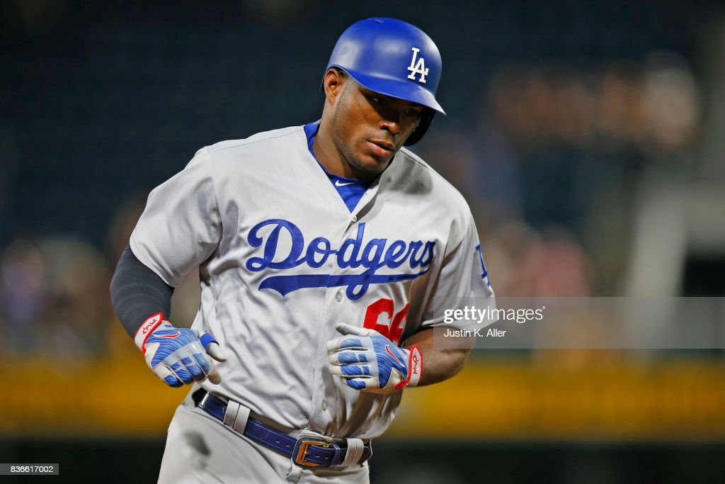 Yasiel Puig #66 of the Los Angeles Dodgers rounds third after hitting a solo home run in the twelfth inning against the Pittsburgh Pirates at PNC Park on August 21, 2017 in Pittsburgh, Pennsylvania.