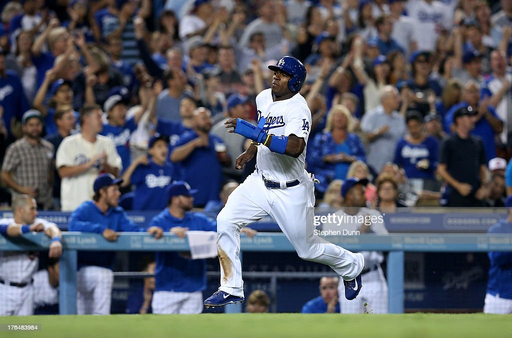 <a gi-track='captionPersonalityLinkClicked' href=/galleries/search?phrase=Yasiel+Puig&family=editorial&specificpeople=10484087 ng-click='$event.stopPropagation()'>Yasiel Puig</a> #66 of the Los Angeles Dodgers runs home to score a run on a two run single by A.J. Ellis in the sixth inning against the New York Mets at Dodger Stadium on August 13, 2013 in Los Angeles, California. The Dodgers won 4-2.