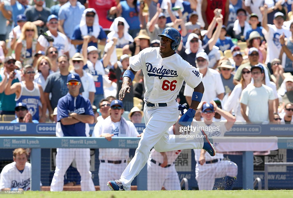 <a gi-track='captionPersonalityLinkClicked' href=/galleries/search?phrase=Yasiel+Puig&family=editorial&specificpeople=10484087 ng-click='$event.stopPropagation()'>Yasiel Puig</a> #66 of the Los Angeles Dodgers runs homw to score a run against the Colorado Rockies leaps for a high throw in the fifth ininng at Dodger Stadium on July 14, 2013 in Los Angeles, California.