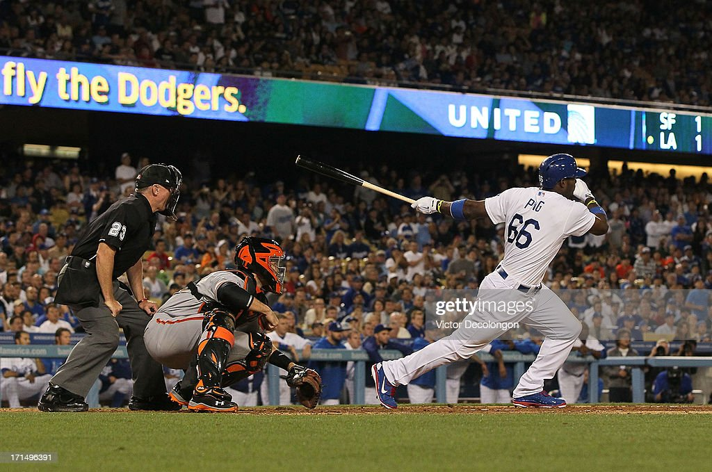 <a gi-track='captionPersonalityLinkClicked' href=/galleries/search?phrase=Yasiel+Puig&family=editorial&specificpeople=10484087 ng-click='$event.stopPropagation()'>Yasiel Puig</a> #66 of the Los Angeles Dodgers singles to left field in the eighth inning to score Nick Punto #7 (not in photo) from third base during the MLB game against the San Francisco Giants at Dodger Stadium on June 24, 2013 in Los Angeles, California. The Dodgers defeated the Giants 3-1.