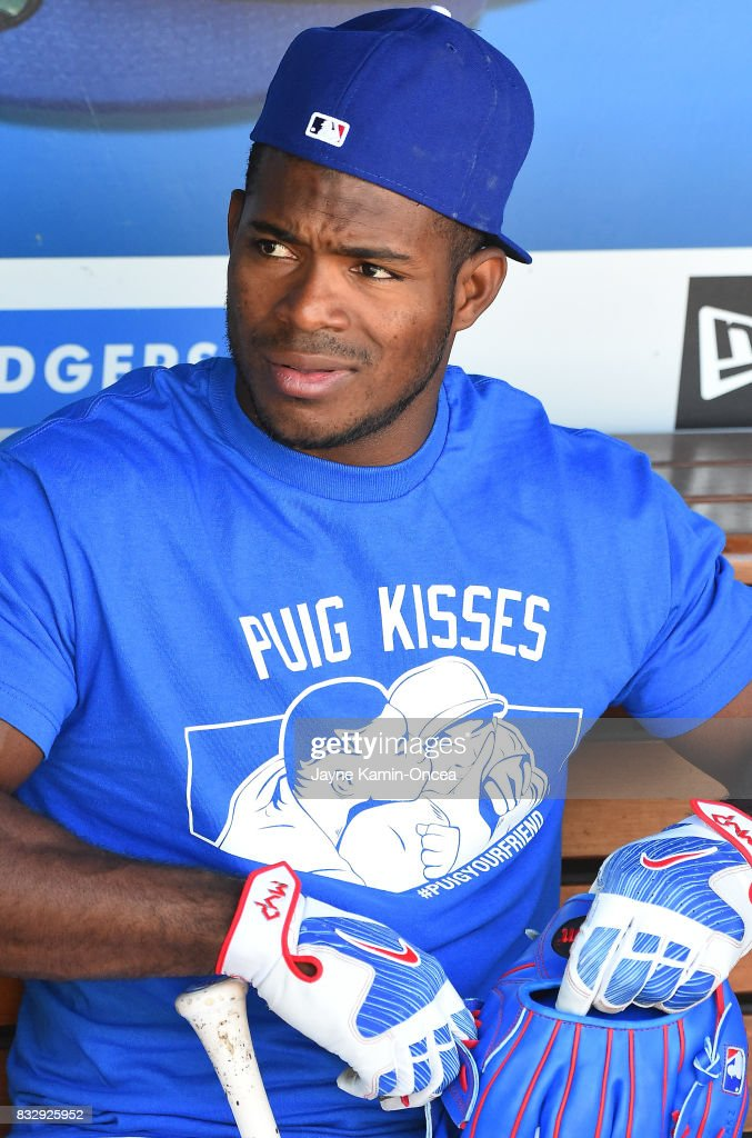 Yasiel Puig #66 of the Los Angeles Dodgers sits in the dugout before the game against the Chicago White Sox at Dodger Stadium on August 16, 2017 in Los Angeles, California.