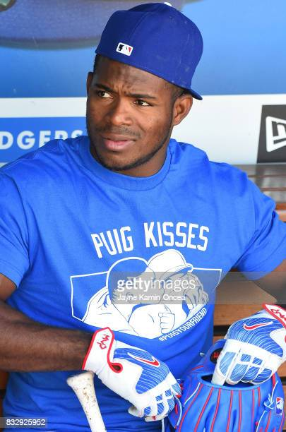 Yasiel Puig of the Los Angeles Dodgers sits in the dugout before the game against the Chicago White Sox at Dodger Stadium on August 16 2017 in Los...