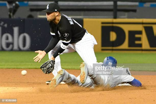 Yasiel Puig of the Los Angeles Dodgers steals second base as Yoan Moncada of the Chicago White Sox takes the throw during the fourth inning on July...