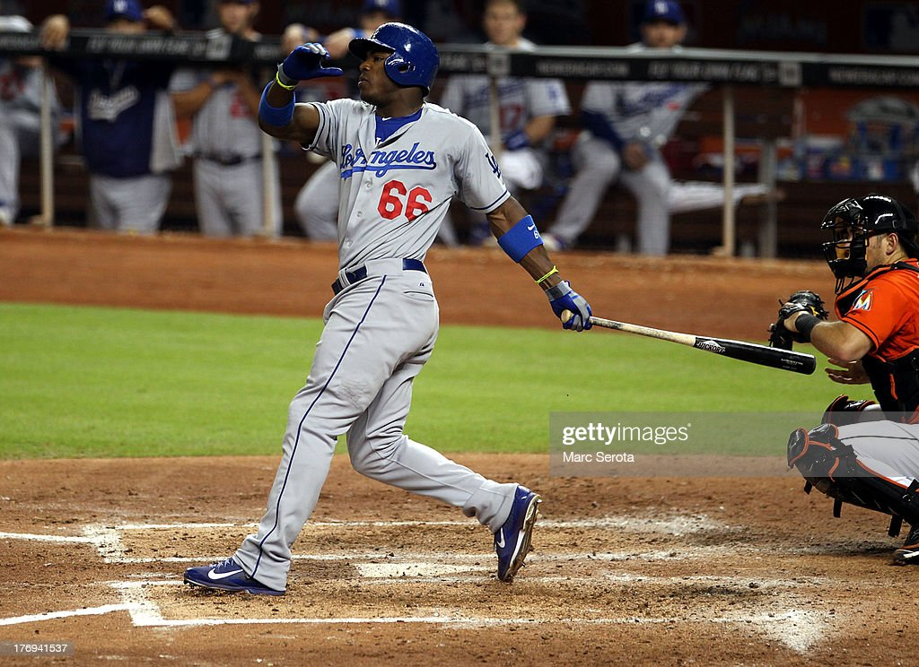 <a gi-track='captionPersonalityLinkClicked' href=/galleries/search?phrase=Yasiel+Puig&family=editorial&specificpeople=10484087 ng-click='$event.stopPropagation()'>Yasiel Puig</a> #66 of the Los Angeles Dodgers strikes out in the fifth inning against the Miami Marlins at Marlins Park on August 19, 2013 in Miami, Florida. The Marlins defeated the Dodgers 6-2.