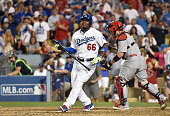 Yasiel Puig of the Los Angeles Dodgers strikes out swinging with the tying run on third base for the last out of Game One of the National League...