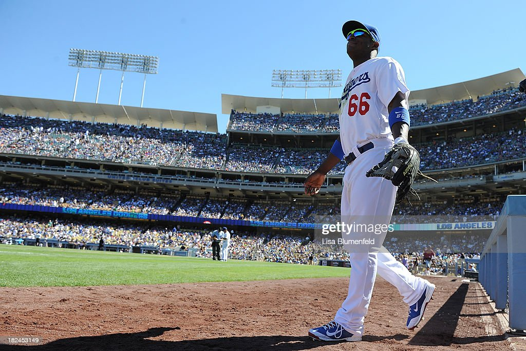 <a gi-track='captionPersonalityLinkClicked' href=/galleries/search?phrase=Yasiel+Puig&family=editorial&specificpeople=10484087 ng-click='$event.stopPropagation()'>Yasiel Puig</a> #66 of the Los Angeles Dodgers walks onto the field to start the game against the Colorado Rockies at Dodger Stadium on September 29, 2013 in Los Angeles, California.