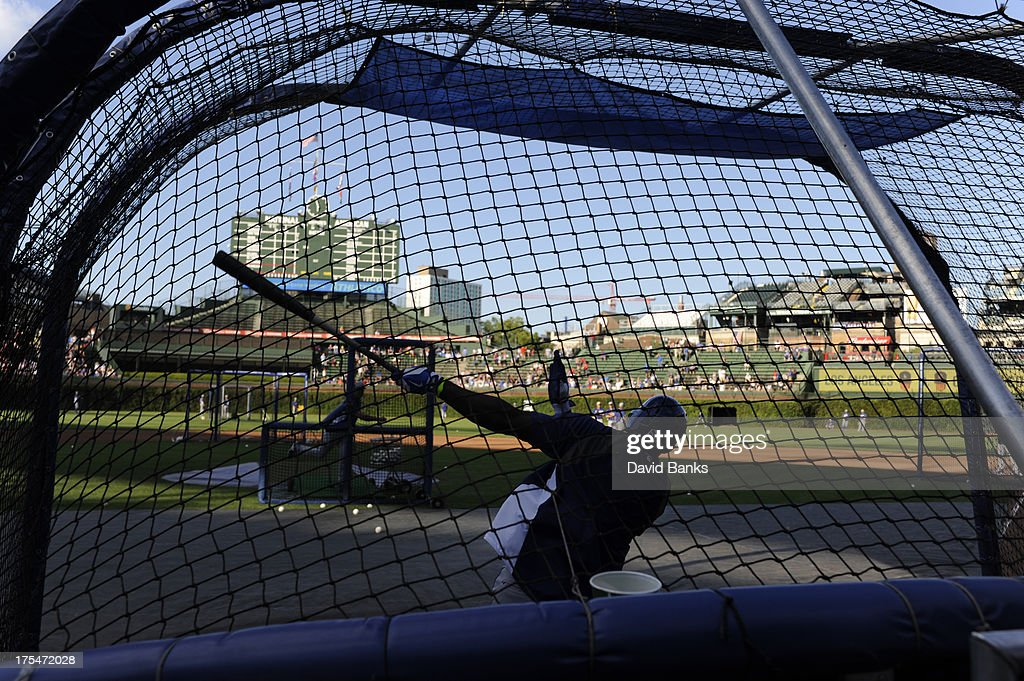 <a gi-track='captionPersonalityLinkClicked' href=/galleries/search?phrase=Yasiel+Puig&family=editorial&specificpeople=10484087 ng-click='$event.stopPropagation()'>Yasiel Puig</a> #66 of the Los Angeles Dodgers warms up before the game against the Chicago Cubs on August 1, 2013 at Wrigley Field in Chicago, Illinois.