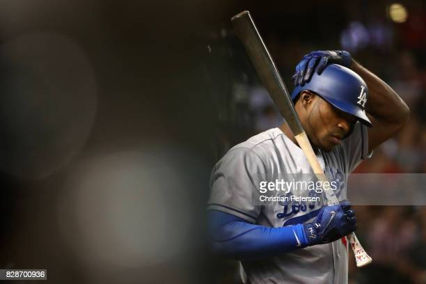 Yasiel Puig of the Los Angeles Dodgers warms up on deck during the second inning of the MLB game against the Arizona Diamondbacks at Chase Field on...