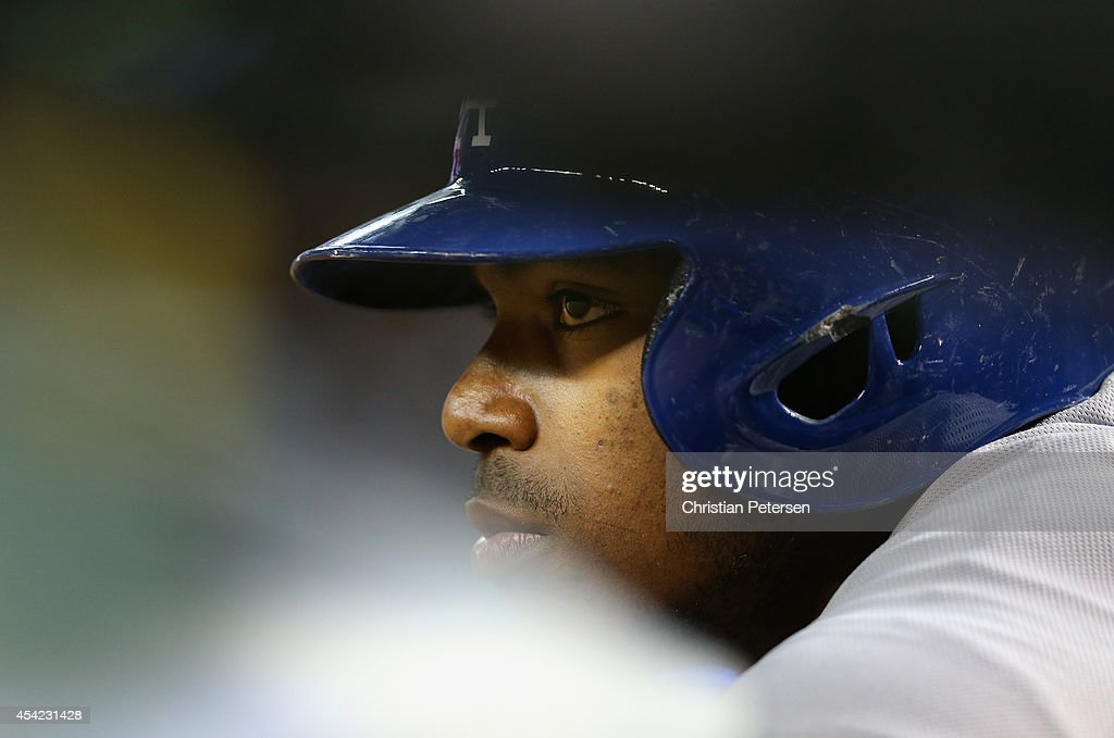 <a gi-track='captionPersonalityLinkClicked' href=/galleries/search?phrase=Yasiel+Puig&family=editorial&specificpeople=10484087 ng-click='$event.stopPropagation()'>Yasiel Puig</a> #66 of the Los Angeles Dodgers watches from the dugout during the MLB game against the Arizona Diamondbacks at Chase Field on August 26, 2014 in Phoenix, Arizona.