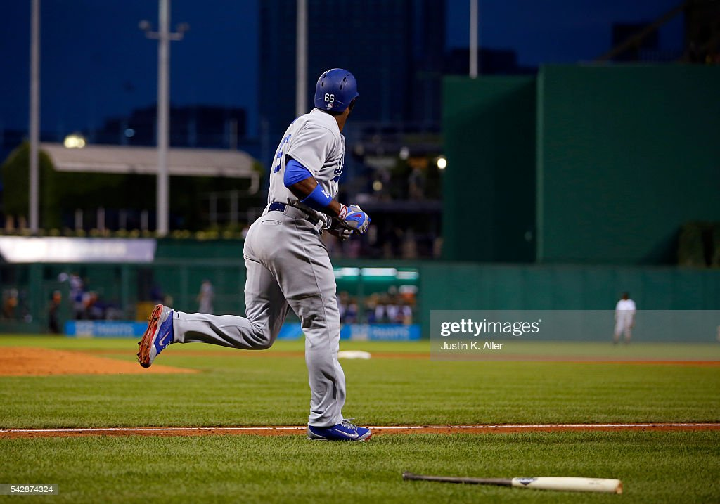 Yasiel Puig #66 of the Los Angeles Dodgers watches his sixth inning home run against the Pittsburgh Pirates during the game at PNC Park on June 24, 2016 in Pittsburgh, Pennsylvania.