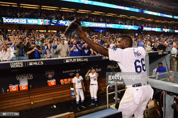 Yasiel Puig of the Los Angeles Dodgers waves to fans after defeating the Chicago Cubs 41 in game two of the National League Championship Series at...