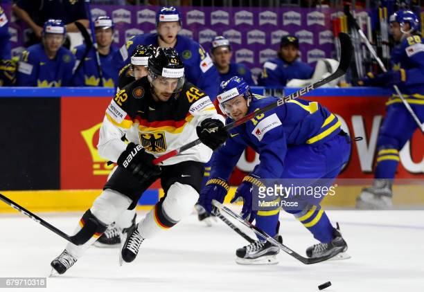 Yasin Ehliz of Germany challenges Marcus Kruger of Sweden for the puck during the 2017 IIHF Ice Hockey World Championship game between Germany and...
