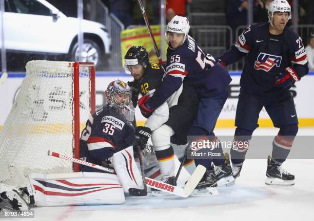 Yasin Ehliz of Germany is challenged by Jimmy Howard and Noah Hanifin of USA during the 2017 IIHF Ice Hockey World Championship game between USA and...