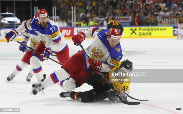 Yasin Ehliz of Germany is challenged by Sergei Andronov of Russia during the 2017 IIHF Ice Hockey World Championship game between Germany and Russia...
