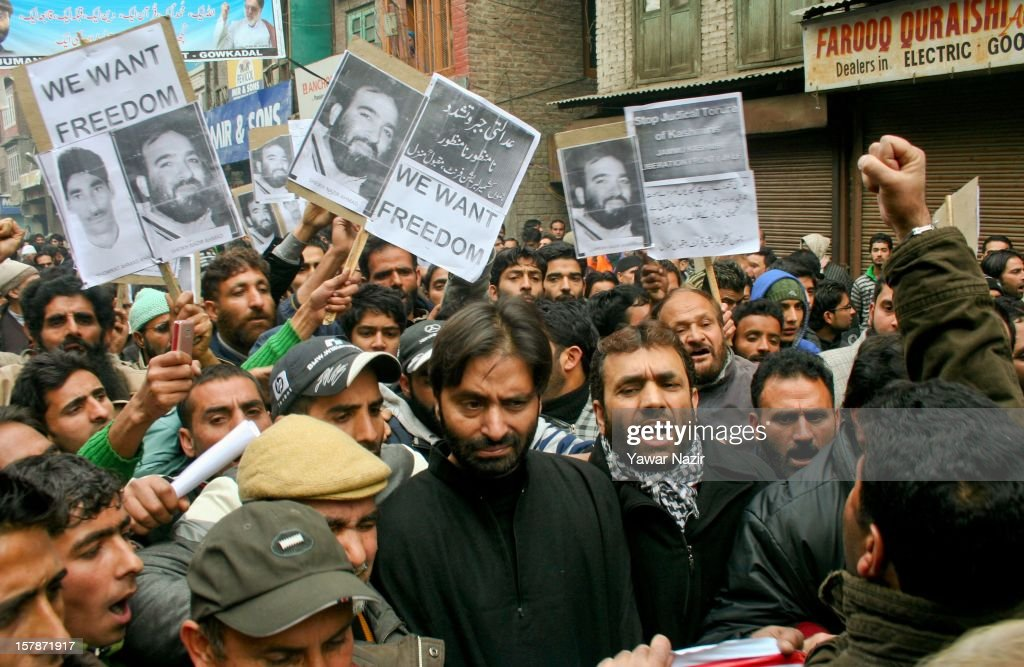 <a gi-track='captionPersonalityLinkClicked' href=/galleries/search?phrase=Yasin+Malik&family=editorial&specificpeople=691200 ng-click='$event.stopPropagation()'>Yasin Malik</a> (C), chairman of the JKLF and his supporters carry a banners during a protest against a court verdict sentencing of two Kashmiris to life imprisonment for their involvement in separatist violence on December 07, 2012 in Srinagar, the summer capital of Indian administered Kashmir, India. Hundreds of supporters of the pro-independence Jammu and Kashmir Liberation Front (JKLF), lead by the organization's chairman <a gi-track='captionPersonalityLinkClicked' href=/galleries/search?phrase=Yasin+Malik&family=editorial&specificpeople=691200 ng-click='$event.stopPropagation()'>Yasin Malik</a>, threw stones at Indian police during the protest, which lead to the arrest of Malik and several of his aides.