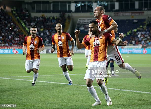 Yasin Oztekin of Galatasaray celebrates with his teammate Wesley Sneijder after scoring a goal during the Turkish Spor Toto Super League football...