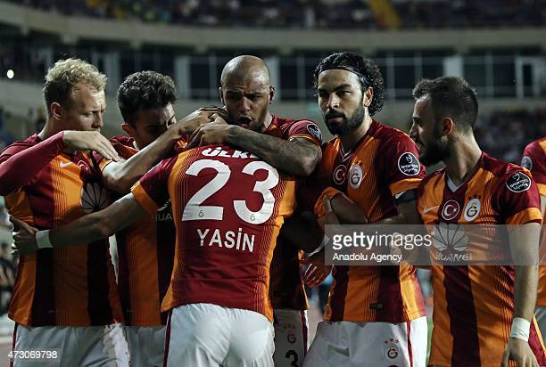 Yasin Oztekin of Galatasaray celebrates with his teammates after scoring a goal during the Turkish Spor Toto Super League football match between...