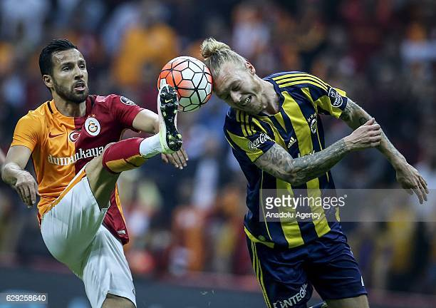 Yasin Oztekin of Galatasaray in action against Simon Kjaer of Fenerbahce during the Turkish Spor Toto Super Lig football match between Galatasaray...