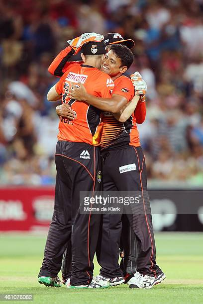 Yasir Arafat of the Perth Scorchers celebrates with teammates after the Scorchers won the game during the Big Bash League match between the Adelaide...