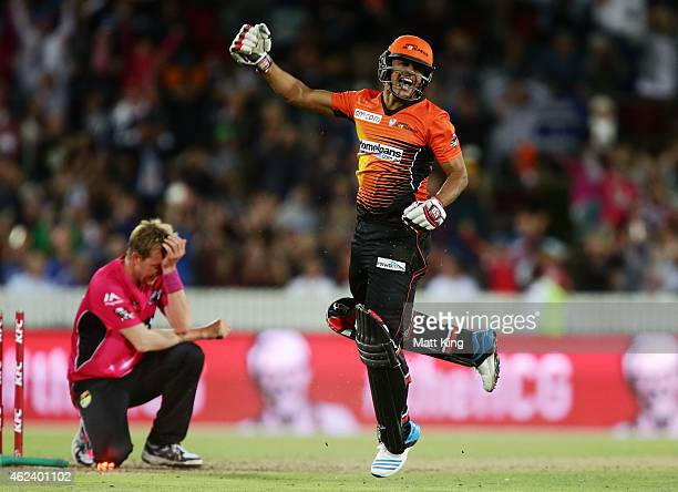 Yasir Arafat of the Scorchers celebrates victory as Brett Lee of the Sixers looks dejected during the Big Bash League final match between the Sydney...