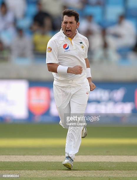 Yasir Shah of Pakistan celebrates dismissing England captain Alastair Cook during day two of the 2nd test match between Pakistan and England at Dubai...