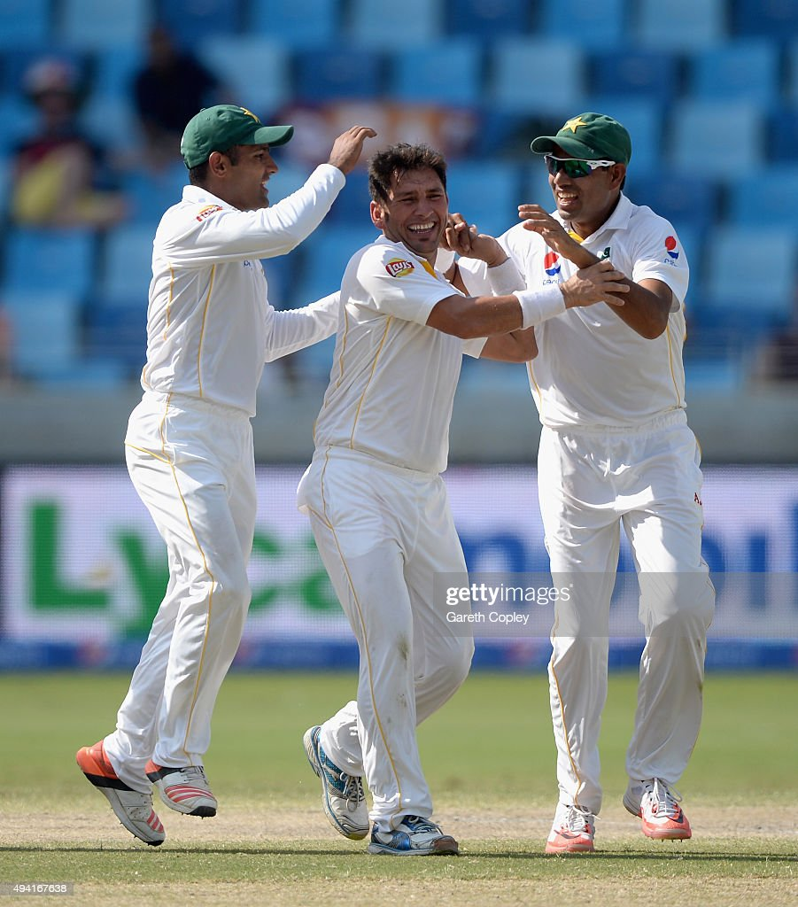 <a gi-track='captionPersonalityLinkClicked' href=/galleries/search?phrase=Yasir+Shah+-+Cricket+Player&family=editorial&specificpeople=14712994 ng-click='$event.stopPropagation()'>Yasir Shah</a> of Pakistan celebrates with <a gi-track='captionPersonalityLinkClicked' href=/galleries/search?phrase=Asad+Shafiq&family=editorial&specificpeople=7061328 ng-click='$event.stopPropagation()'>Asad Shafiq</a> and Zulfiqar Babar after dismissing England captain Alastair Cook during day four of the 2nd test match between Pakistan and England at Dubai Cricket Stadium on October 25, 2015 in Dubai, United Arab Emirates.