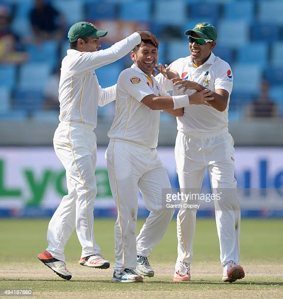 Yasir Shah of Pakistan celebrates with Asad Shafiq and Zulfiqar Babar after dismissing England captain Alastair Cook during day four of the 2nd test...
