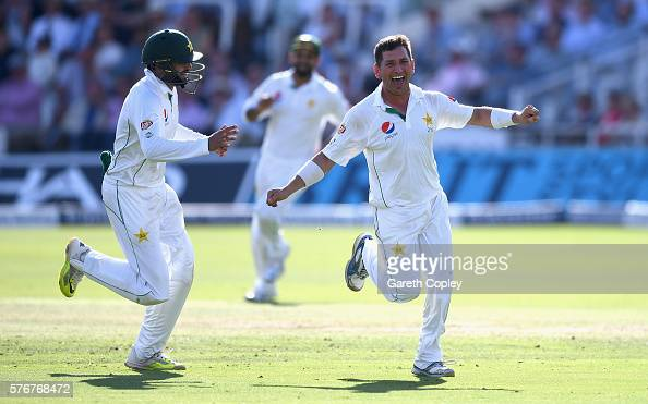 Yasir Shah of Pakistan celebrates with Azhar Ali after dismissing Chris Woakes of England during day four of the 1st Investec Test between England...
