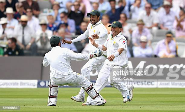 Yasir Shah of Pakistan celebrates with Mohammad Amir and Sarfraz Ahmed after dismissing Joe Root of England during day four of the 1st Investec Test...