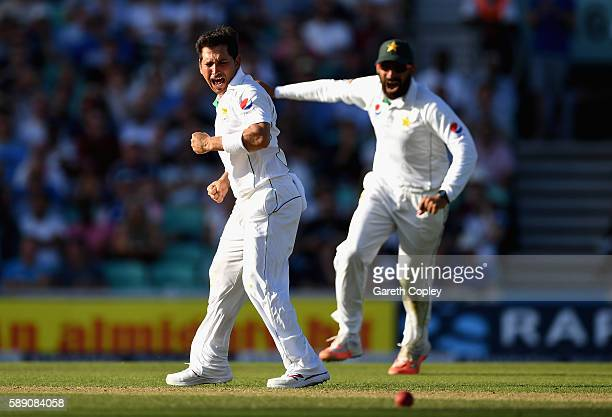 Yasir Shah of Pakistan celebrates with Pakistan captain MisbahulHaq after dismissing Joe Root of England during day three of the 4th Investec Test...