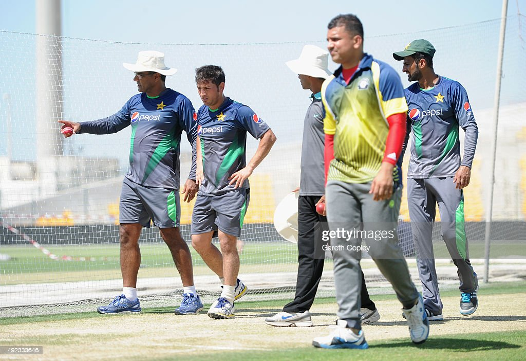 Yasir Shah of Pakistan leaves the nets alongside coach Waqar Younis after picking up an injury during a nets session at Zayed Cricket Stadium on October 12, 2015 in Abu Dhabi, United Arab Emirates.